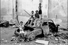Kids playing on carwreck, Havana